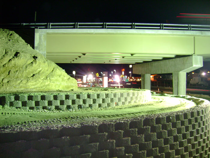 Photo of bridge construction at night